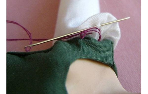 Needlework progressing around the sleeve