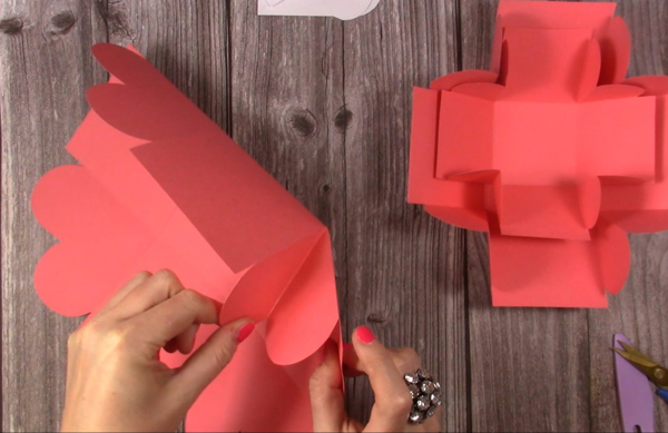 cutting around heart shape for exploding box card