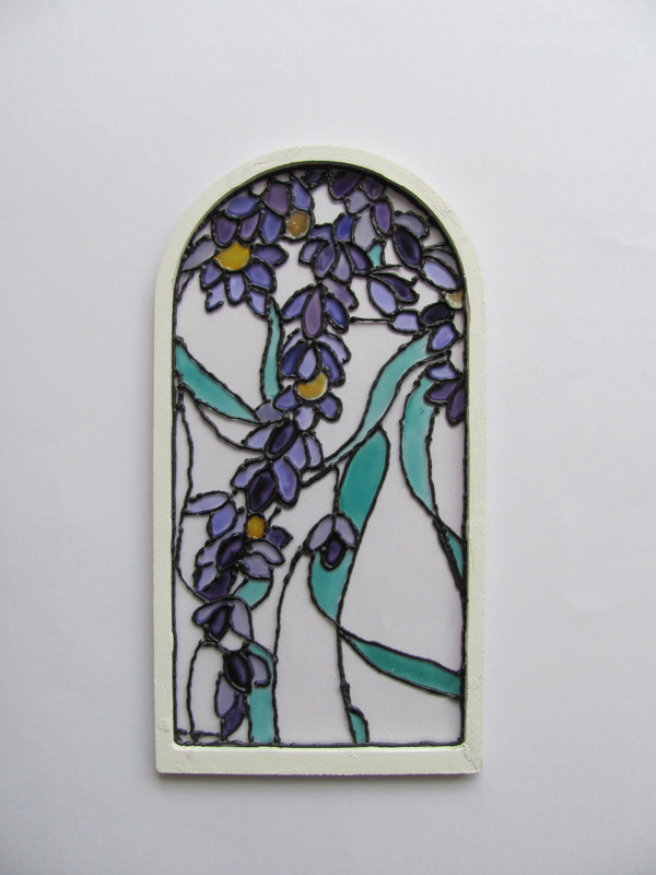 miniature glass painted window fixed to frame