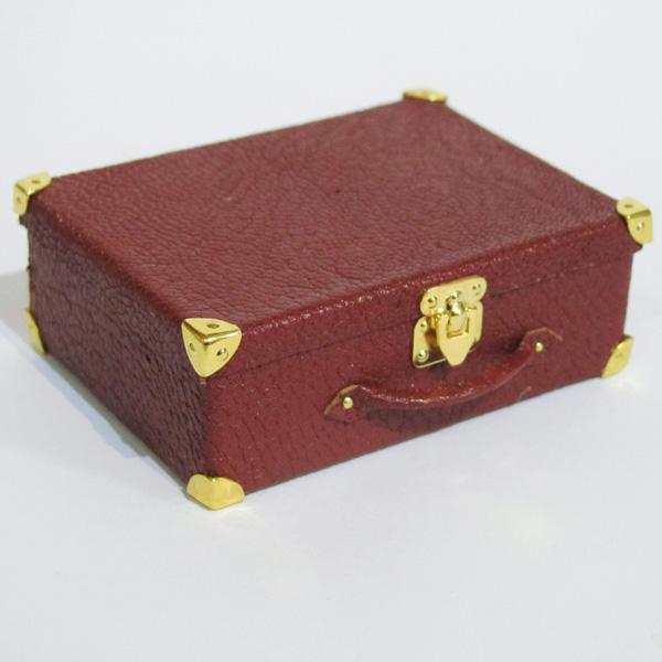 finished miniature leather suitcase