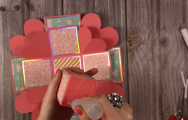 adhering card pieces to exploding box card