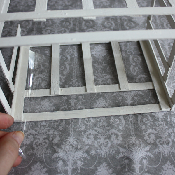 gluing clear sheets to miniature greenhouse