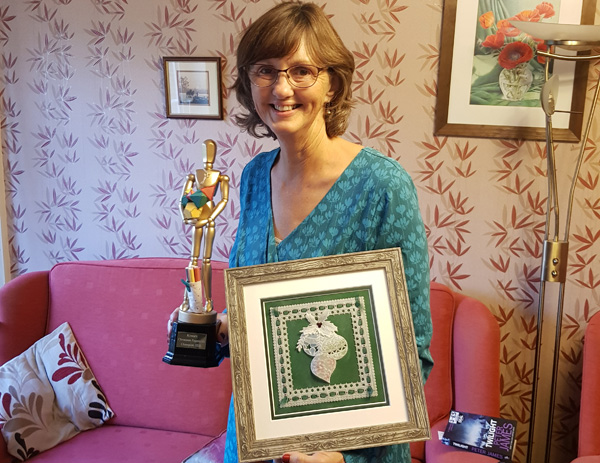 Alison Yeates with her winning creation and trophy