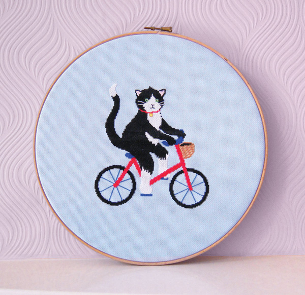 Cat riding a bike cross stitch design by Vicky's World