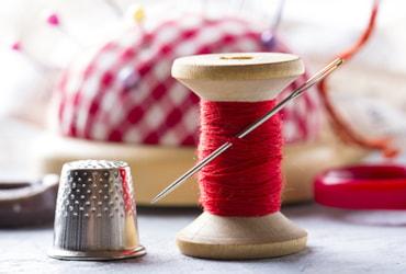 stitching needle, thread, thimble
