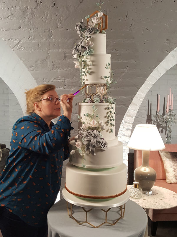 Christine-Jensen-setting-up-a-tiered-cake