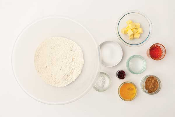 Ingredients in bowls to colour gingerbread