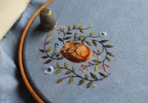 Embroidered sleeping fox by Chloe Giordano