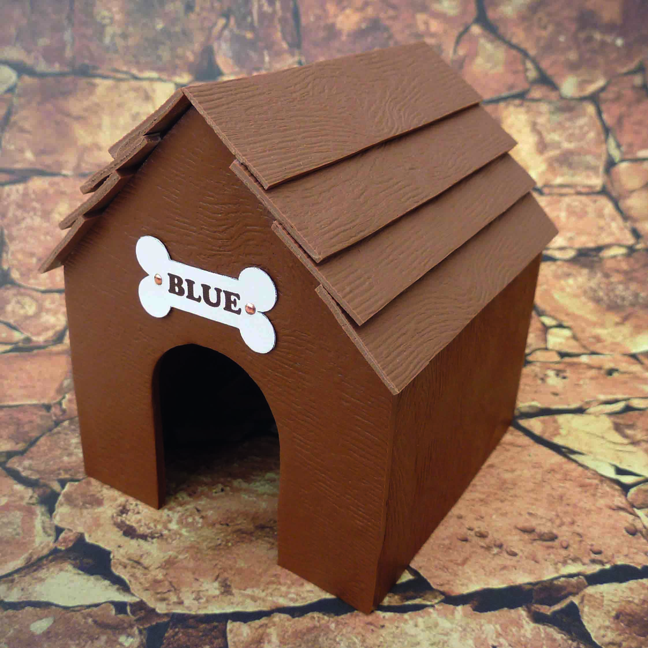 miniature dog kennel made from polymer clay