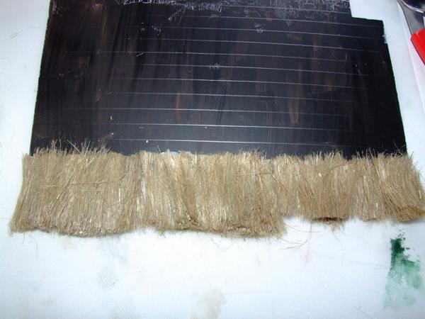 Gluing plumbers hemp to miniature roof