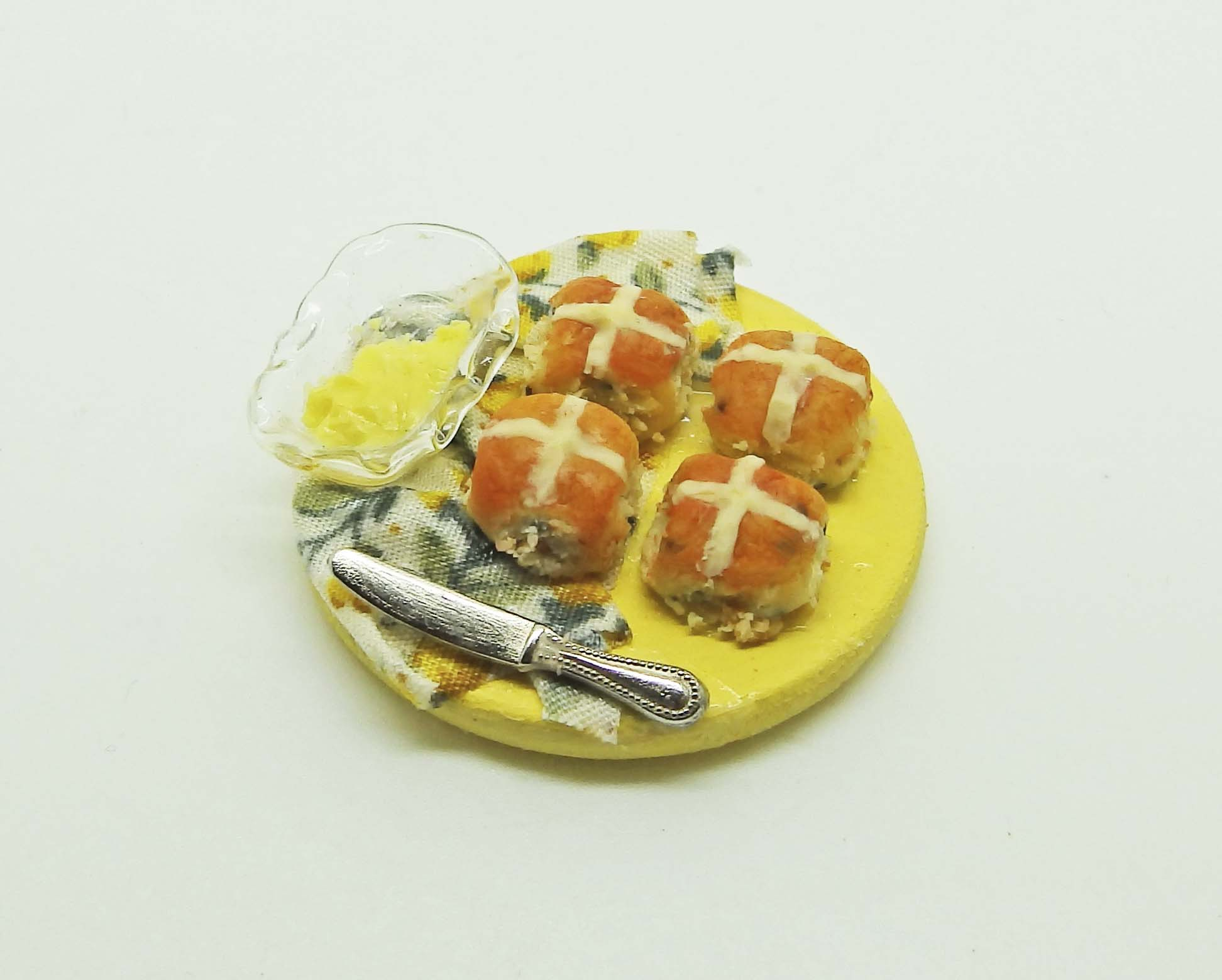 Finished hot cross buns in polymer clay