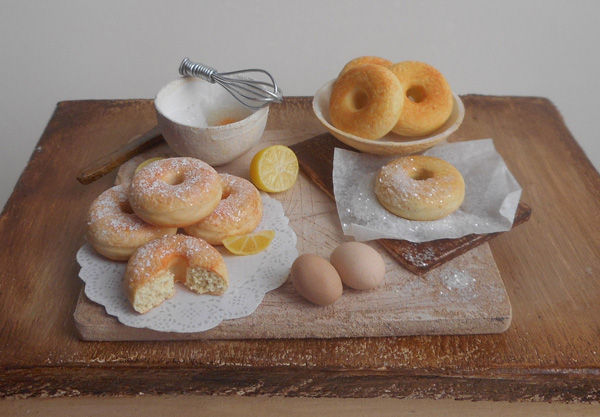 Polymer clay bagels, eggs and lemons on a board