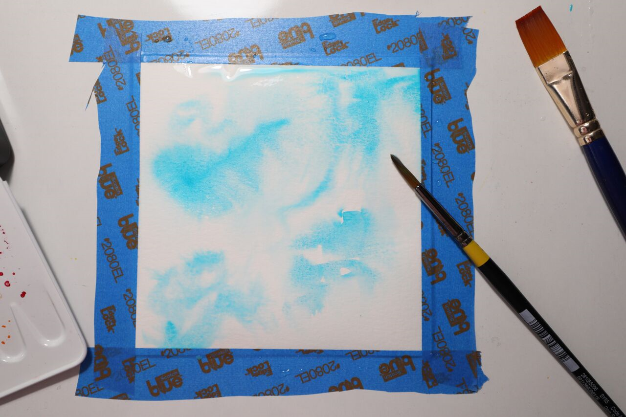 1 Spritz white watercolour card with water.