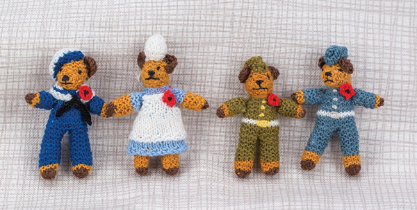 Knitted miniature Remembrance Day bears