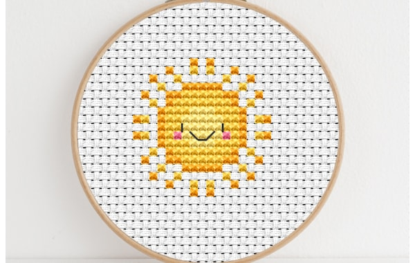 Sunshine cross stitch design in hoop by Lucie Heaton