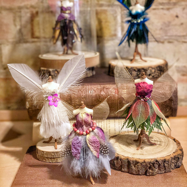 Discarded fairy couture pieces on mannequins