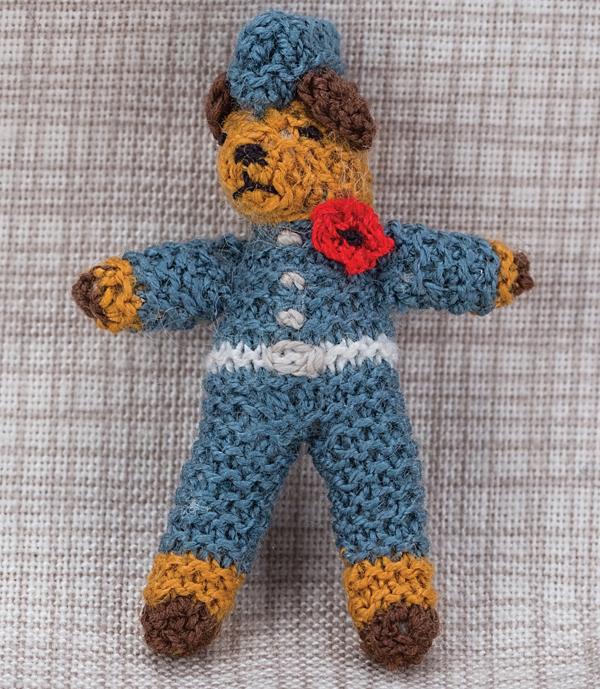 Miniature knitted airman bear