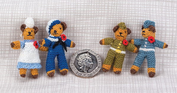 Miniature knitted bears for Remembrance Day with 20p piece