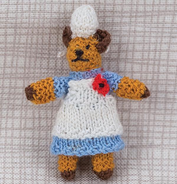 Miniature knitted nurse bear
