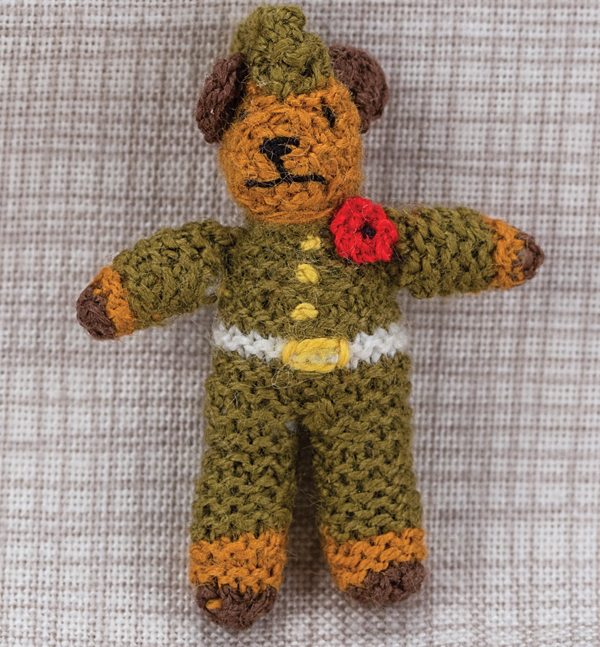 Miniature knitted soldier bear