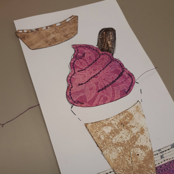 Machine stitching collages pieces on card