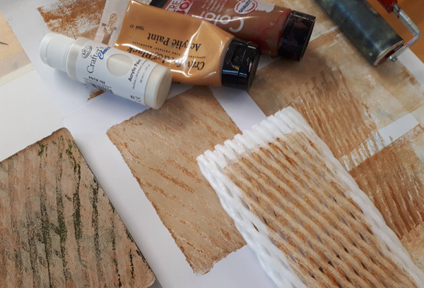 texture with food packaging and acrylics