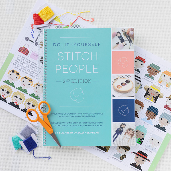 Stitch People book, charts, threads, scissors