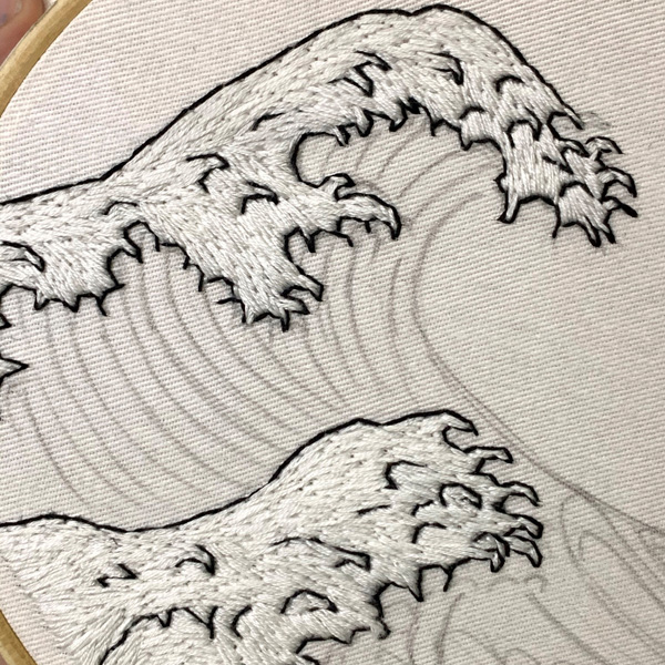 Hand embroidered waves