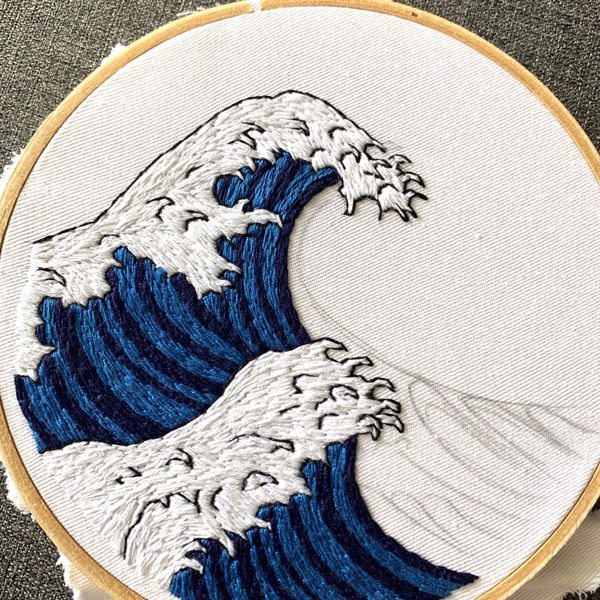 Finished hand embroidered wave in hoop