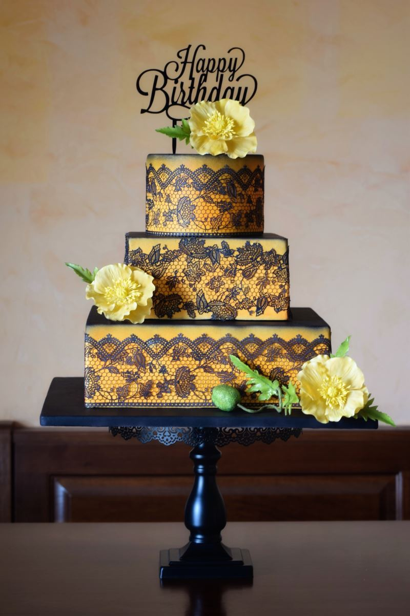 Veronica Seta black cake with gold lace