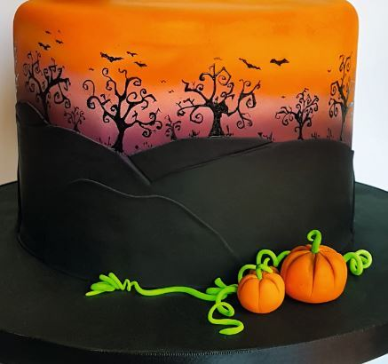 Airbrush spooky sunset cake