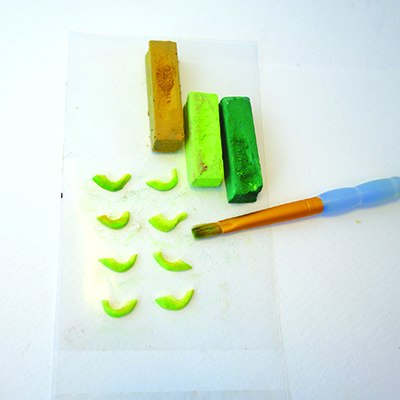 Using pastels to add colour to polymer clay avocado slices