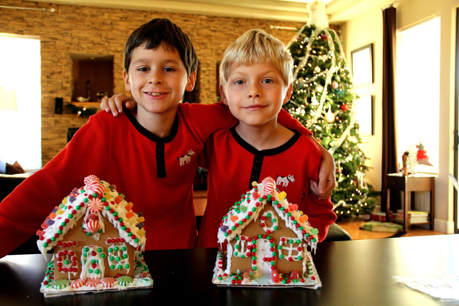 Two boys decorating gingerbread