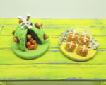 miniature Easter cake and hot cross buns in polymer clay