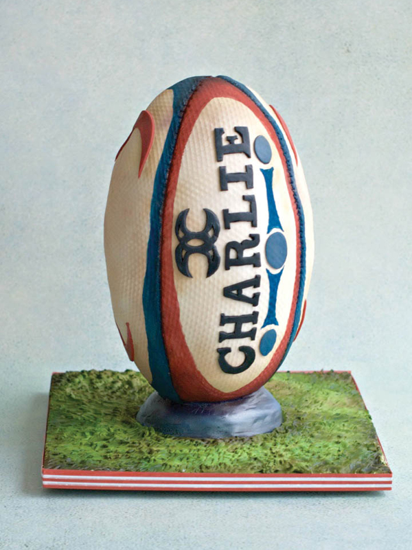 rugby ball cake on longer edible grass