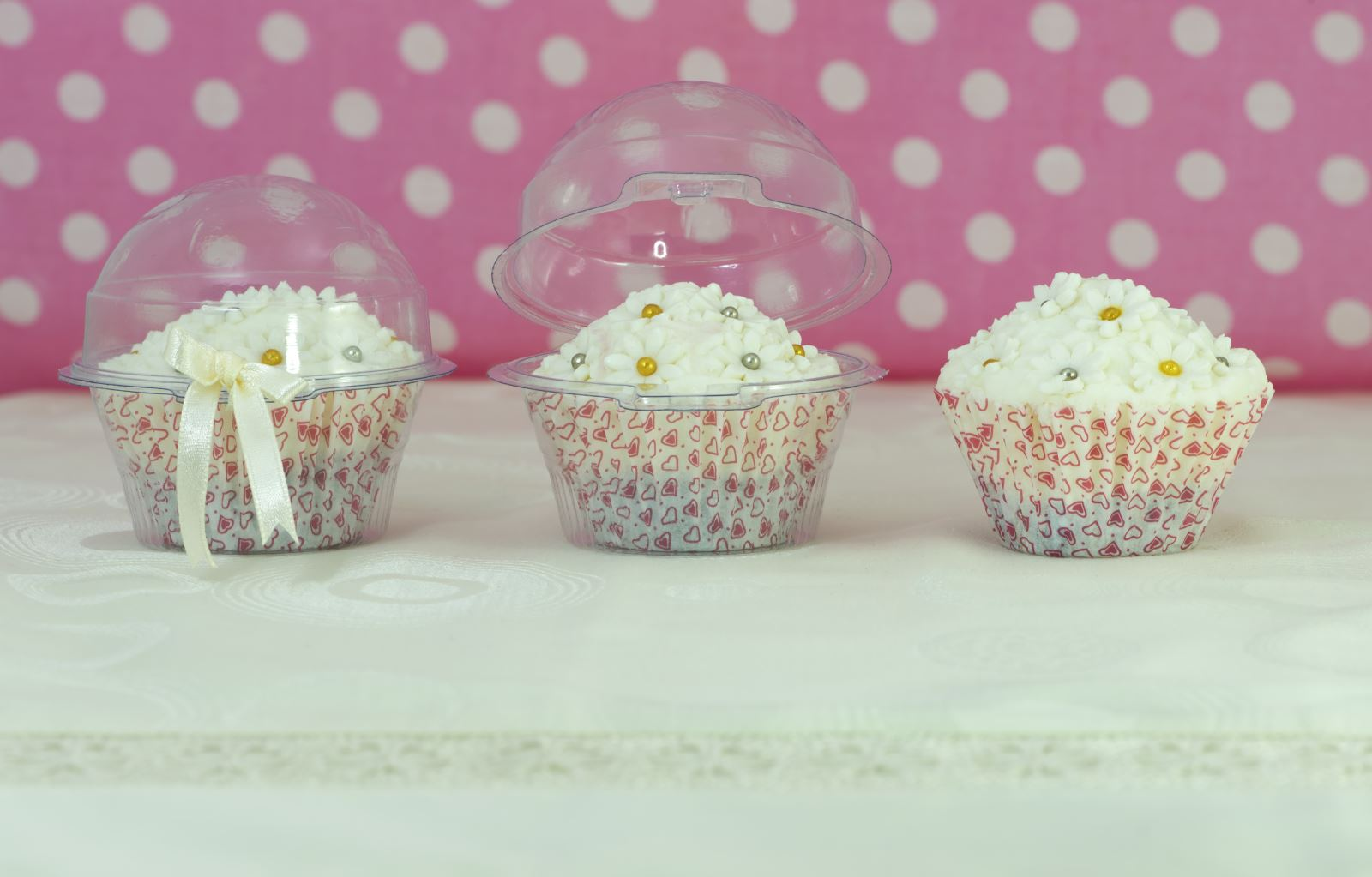 covering decorated cupcakes