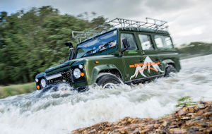 Land Rover driving through water