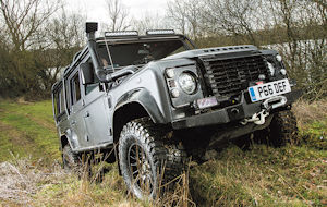 Land Rover driving up bank