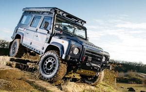 Land Rover driving down steep bank