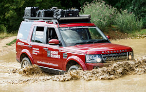 Land Rover driving through deep water