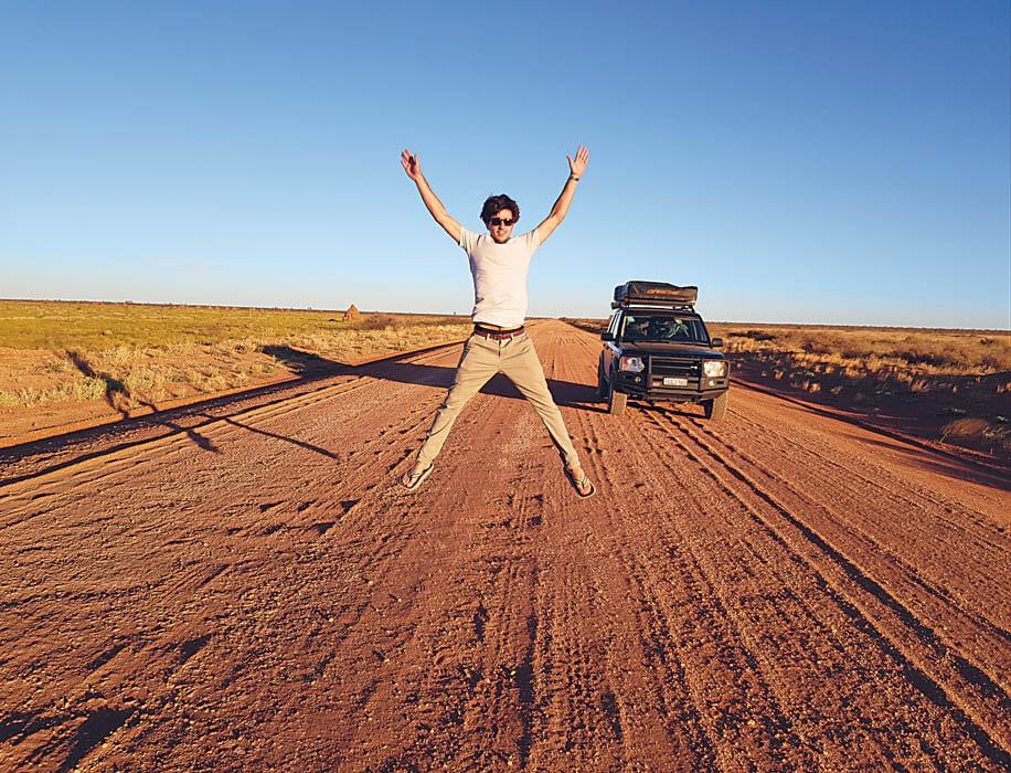 Discovery 3 on red desert road, Australia