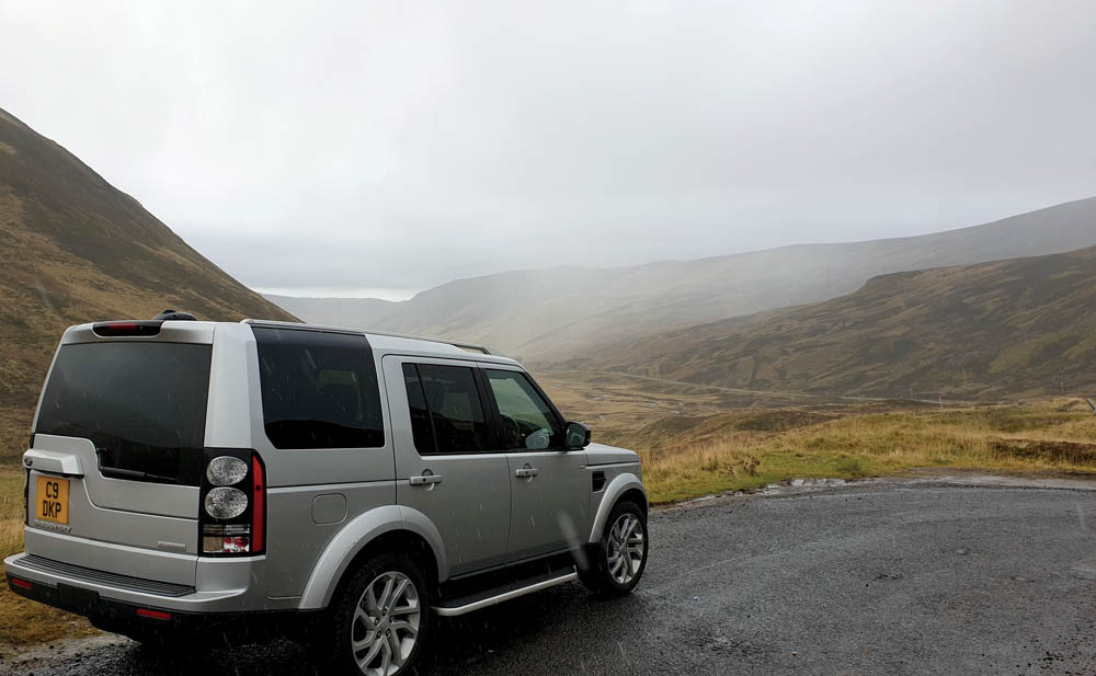 Discovery 4 on a misty day in the Scottish Highlands