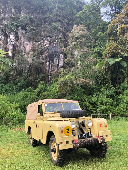 Land Rovers in a forest in Indonesia