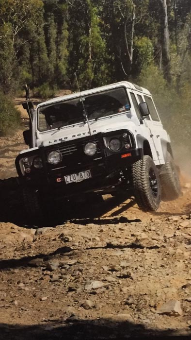 Defender gravel track wheel in the air