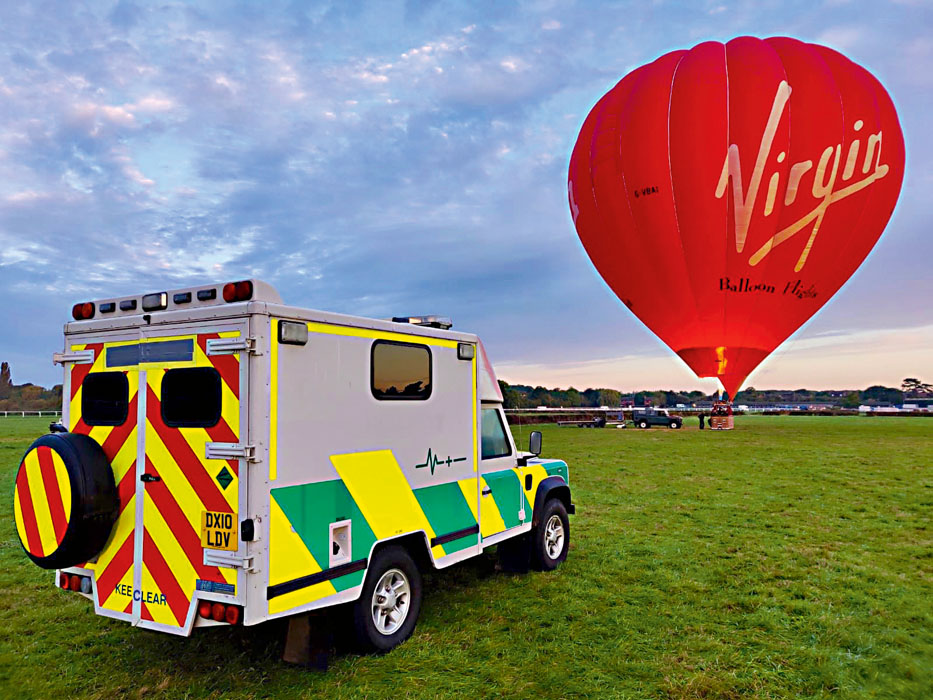 Hot air balloon and Land Rover Defender ambulance