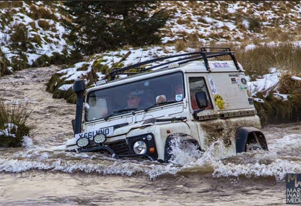 Defender crossing a river