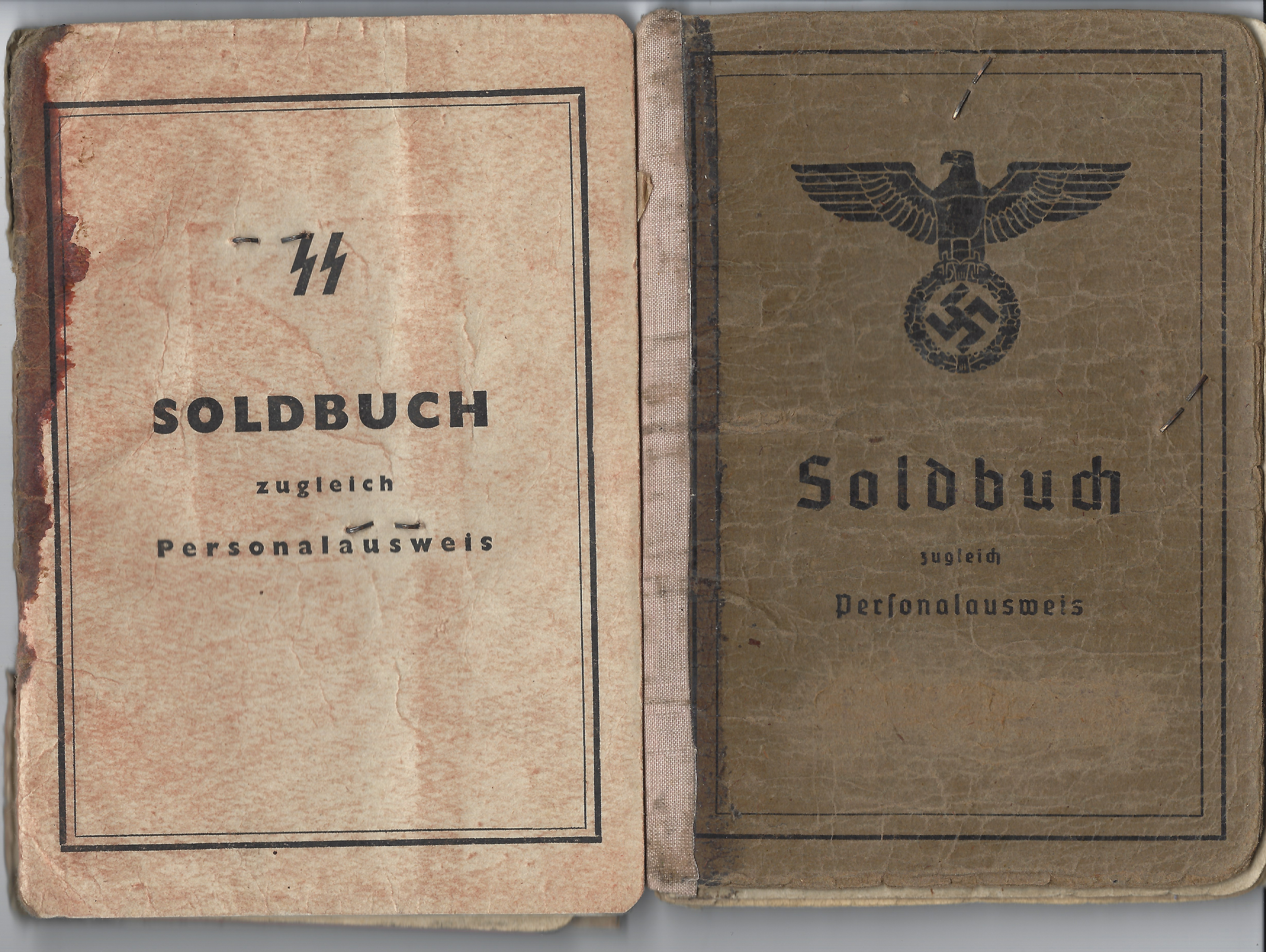 SS Soldbuch and a Wehrmacht Soldbuch, with details written on the cover