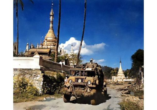 British troops drive past a pagoda in Burma