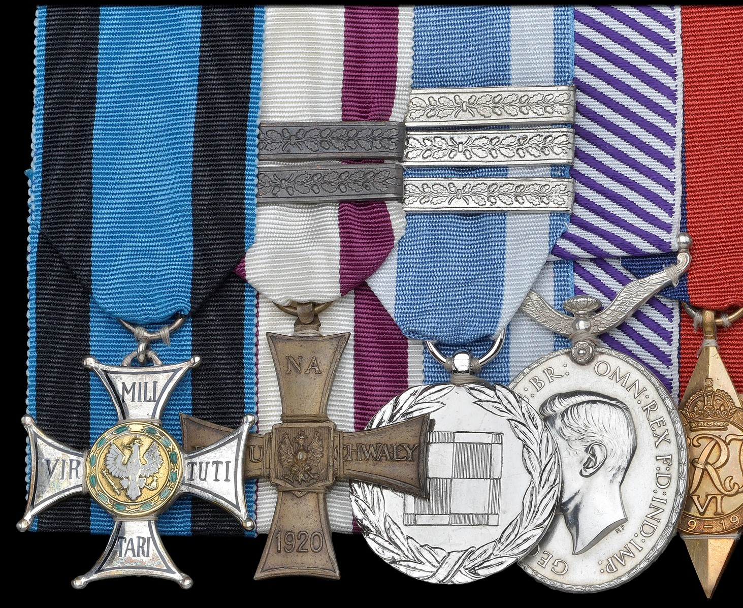 Part of an exceptional gallantry group to a Polish pilot, with the Virtuti Militari and Cross of Valour with three bars and the Polish Air Medal with extra service clasps. Worn with the British DFM
