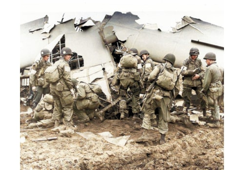 Men of the US 101st Airborne taking supplies from a damaged glider
